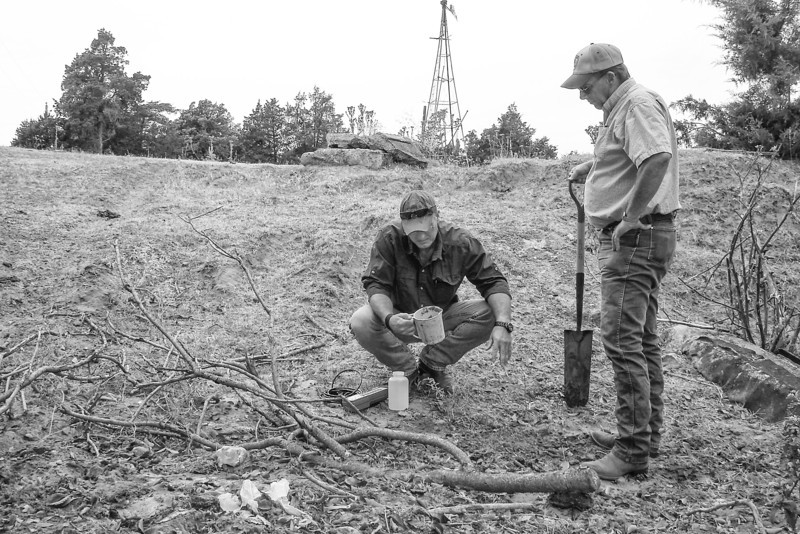 Brad Ice and Mark Huber collect samples from a suspected illigal dump site of drilling water near Fay, OK. PHOTO BY SARAH TERRY-COBO