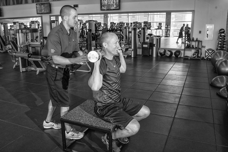 Devon employee Alan Marcum (right) is able to work out at work in their gym know as The Well. Additionally he is able to recieve instruction from on-site trainers such as Ryan Crain.