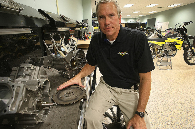 John Fitzpatrick, President and CEO of Highland Inc, at a workbench at the companies Tulsa Office.