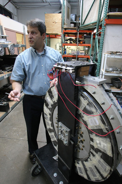 Darin Long, CEO Millennial Research Corporation, stands besides a prototype of the companies new generator.