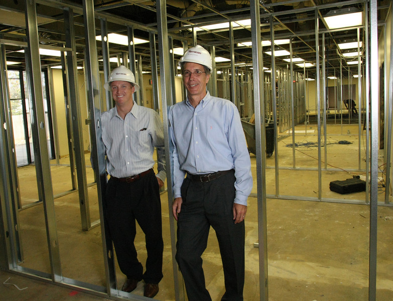 David Cobb  and Michael  Homan pause for a photo in the companies new Tulsa location currently under renovation.