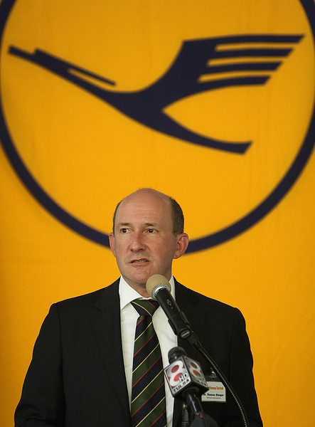 Dr Thomas Stueger, Chief Executive of Product and Services for Lufthansa Tecknik, speaks at a press conference announcing the companies  plans to hire nearly 90 additional workers over the next few years.