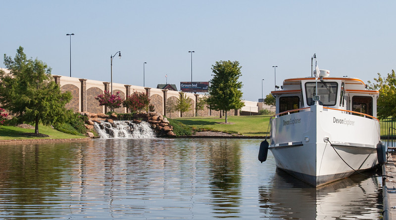 "The Devon tour boat ""Explorer"" docked on the Oklahoma River near the Chesapeak boat house."