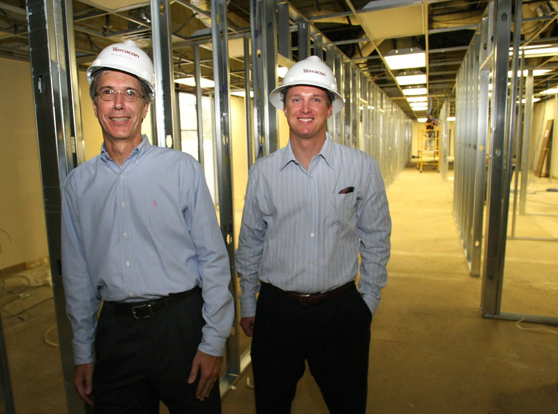 Michael  Homan and David Cobb pause for a photo in the companies new Tulsa location currently under renovation.