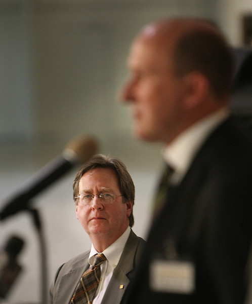 Tulsa Mayor Dewey Bartlett looks on as Dr Thomas Stueger, Chief Executive of Product and Services for Lufthansa Tecknik, speaks at a press conference announcing the companies  plans to hire nearly 90 additional workers over the next few years.
