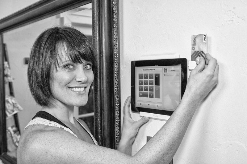 Hair stylist Rebekah Regouby uses Square to take payments from clients. Square allows her to take payments through her iPhone or iPad and works where ever she needs it.