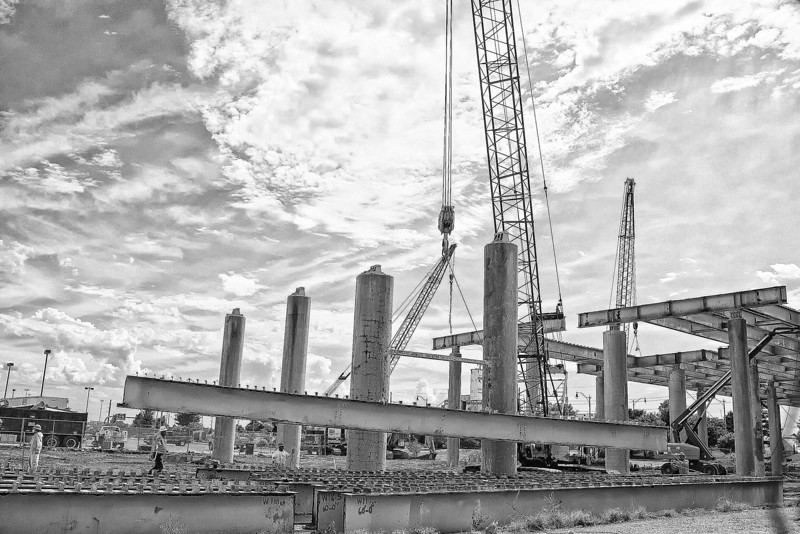 The demolition is nearing an end as the tear of old I-40 down passes south of Bricktown. While the concrete portions of the bridge are being smashed into rubble the large steel cross-beams are being carefully taken apart to be used in other projects around the state.