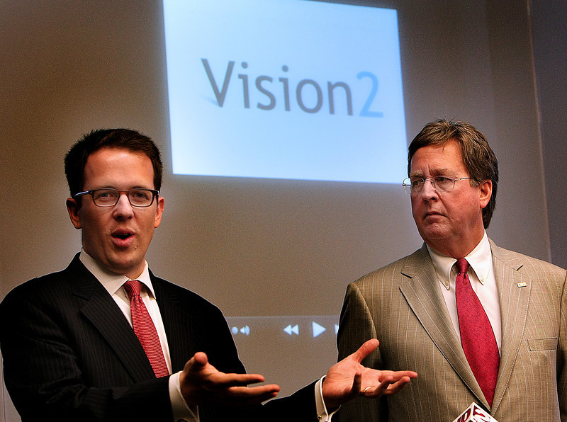 During a Press Conference Tulsa Mayor Dewey Bartlett listens as city counselor JT Bynum explains that citizens of tulsa should comment on projects for inclusion in the Vision 2 tax.