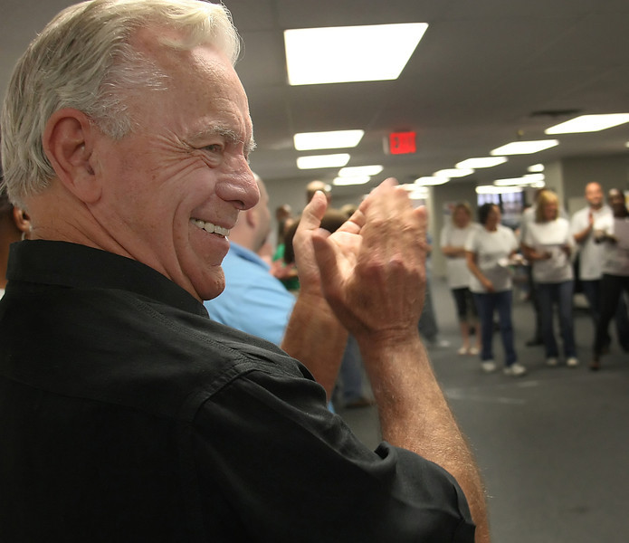 "Bill Bartman, Co-Founder of CFS Two, applauds as he watches  employees participate in their ""Office Olympic Games""."