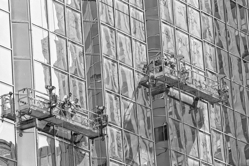 Window washer's make their way down the North side of Leadership Square.