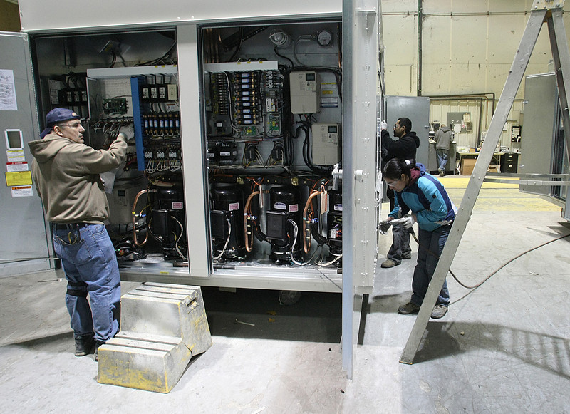 A workmen assembles an industrial air conditioning unit at AAON's Tulsa plant.