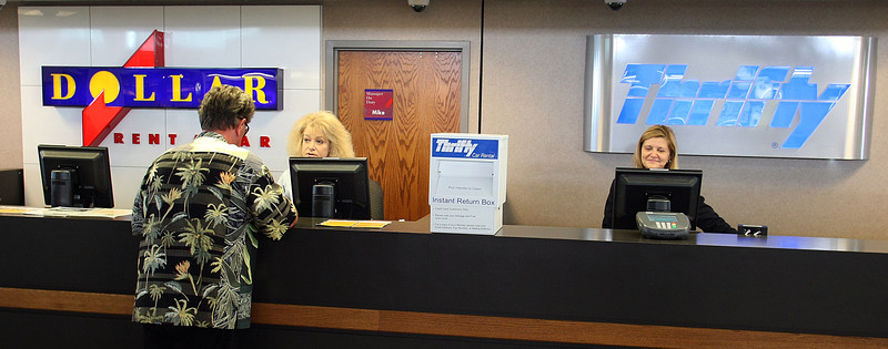 Nancy Zellers and Michelle Heiten work the Dollar and Thrifty rental car counters at the Tulsa International Airport.