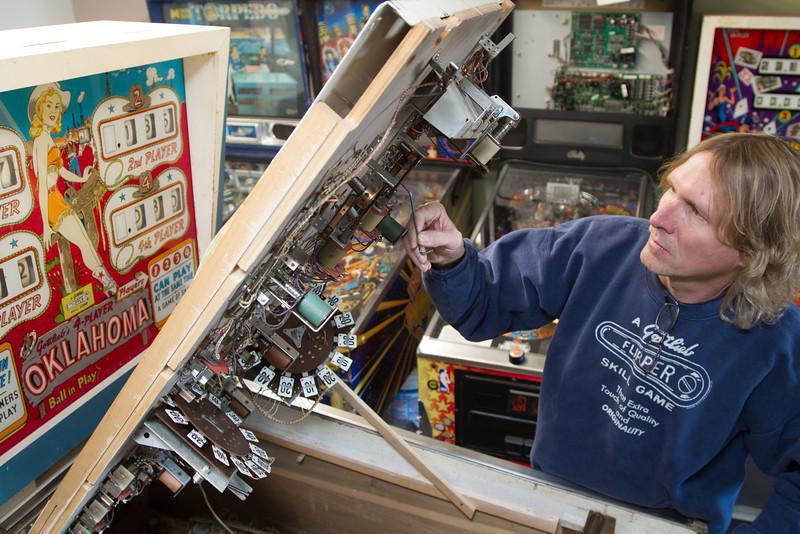 Jimmy Hefner, owner of Metro Pinball and Video. Mr Hefner repairs pinball machines as well as arcade games.