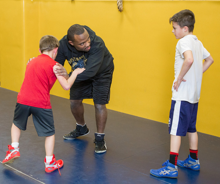 Tyree Ballard coaches youth wrestling practice held at Southmoore Highschool.
