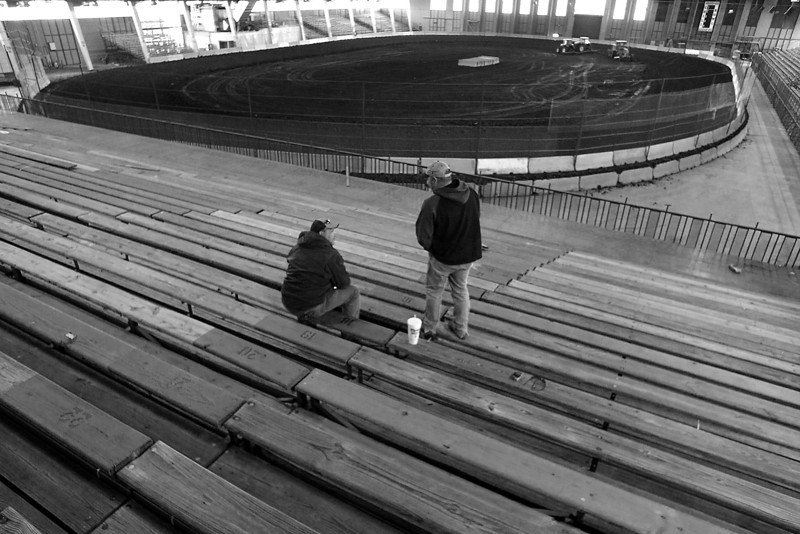 Workmen take a breather while setting up the bleachers for the Chili Bowl nationals at the Tulsa fairgrounds.  The race track and the bleachers were set up in three days inside the QT Center.