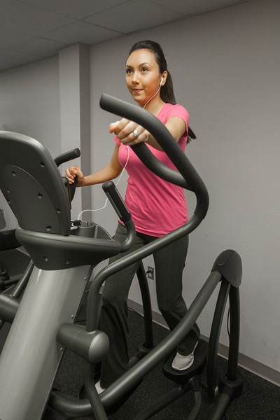 Coral Lam uses the gym at Chapperal Energy for her daily workout.