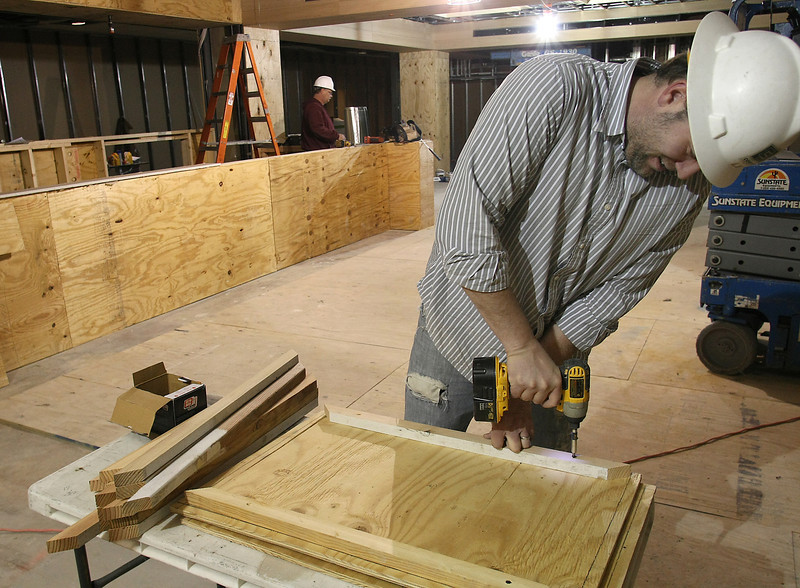 Travis Munch of Cowen construction works to complete the Made Market Tulsa diner in Downtown DoubleTree in Tulsa.