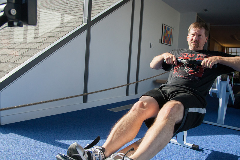 Scott Tomlinson often uses a stationary rowing machine for a cario workout at the employee gym at Chesapeak Energy.