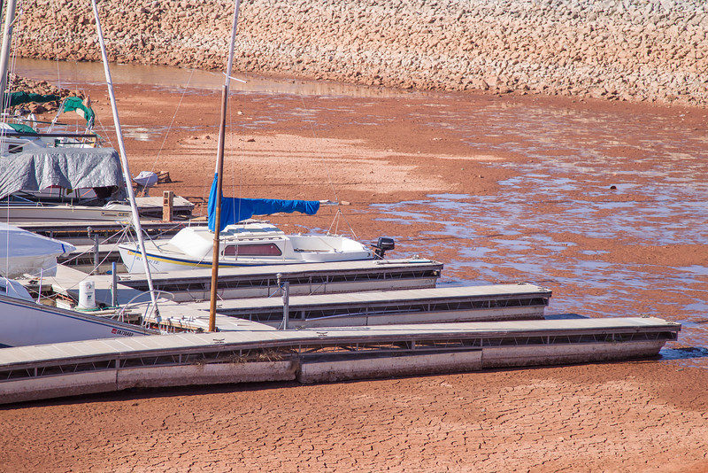 Both dock and boats sit at the bottom of Lake Hefner after water levels remain low after this summers drought. Lake Hefner does not rely on rain water to remain full but rather water is pumped in from other water sources that do.