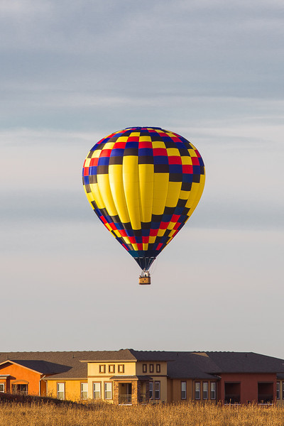 A hot air ballon flies low over northern Oklahoma City near Quail Springs mall.