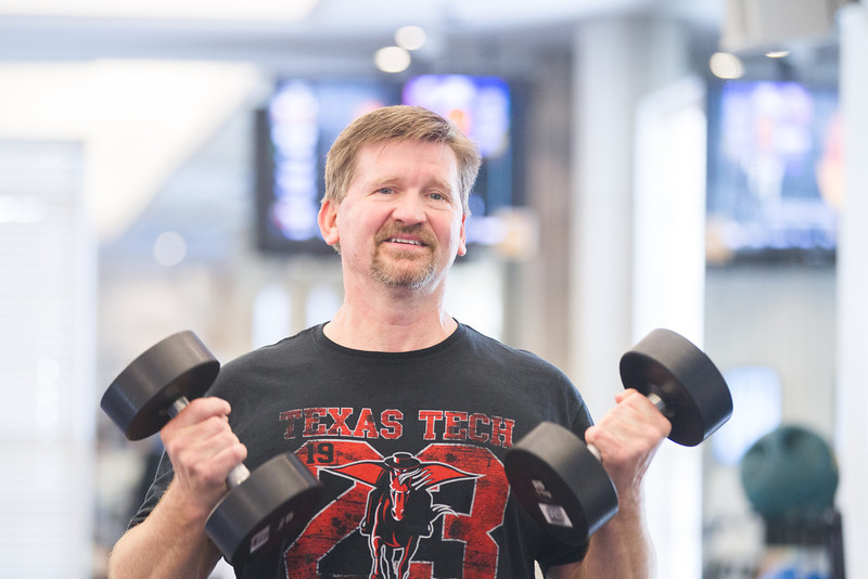 Scott Tomlinson lifts weights in the employee gym at Chesapeak Energy.