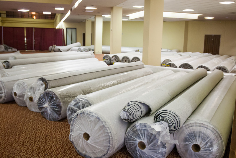 Signs of work at Century Center as old carpet is pulled up and new carpet has been brought in to replace it.