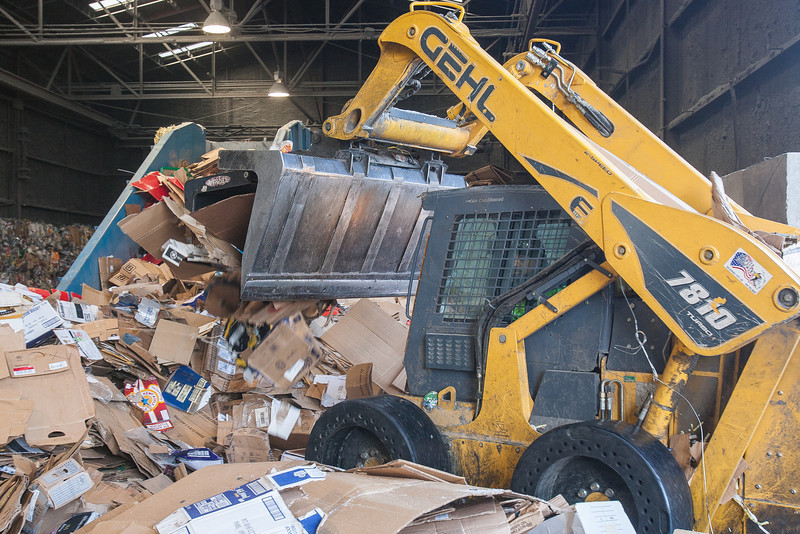 Cardboard being pushed towards a baleing machiine at Greenstar Recycling in Oklahoma City.