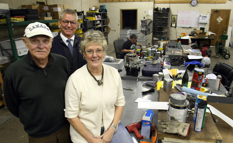 Lon Canada, Tim Lewis and Carol Robinson or CanServ of Tulsa.