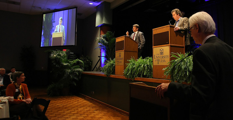 David Huges listens as Terry Engelder participate int the fourth annual Chesapeake Energy Lecture at the University of Tulsa featuring a point-counterpoint discussion on hydraulic fracturing.
