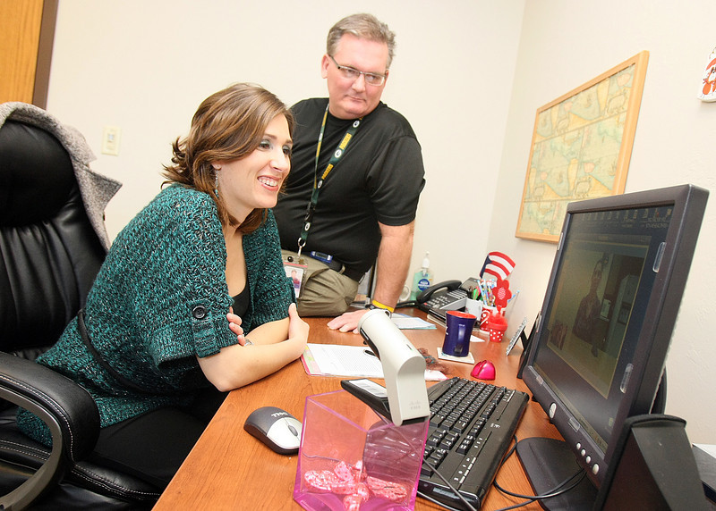 Michelle Maddox, bilingual therapist, and David Howlett, director of behavioral health and special projects with Variety Care, operate the  digital teleconferencing system Wednesday. PHOTO BY MAIKE SABOLICH