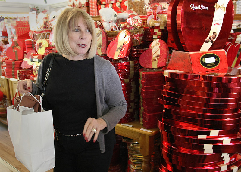 Nancy Tholen loads up on some candy for her grandchildren at the Russell Stover store in Tulsa.