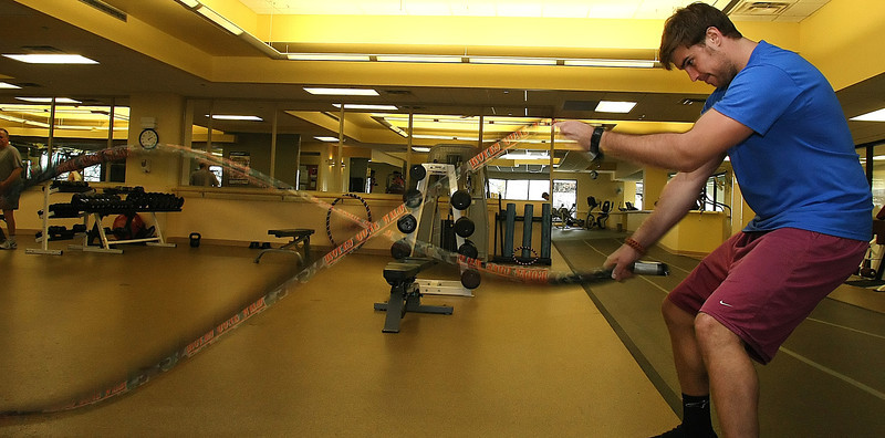 Jason Ervine, an intern at St. John's Hospital in Tulsa, works out with resistance ropes at the hospitals onsite health facility.