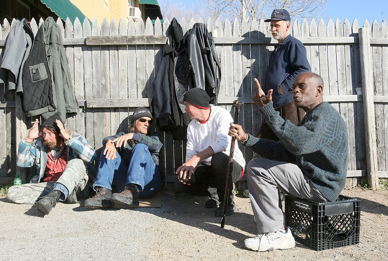 Russell Singleton, Gary Harris, Vance Bryson, Gary Fields and Michael Hinton, right, hang out in front  of the Jesus House Tueadsy. PHOTO BY MAIKE SABOLICH