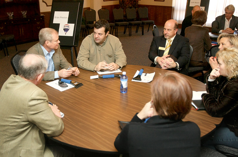 Brian Preston, middle, with Remax leads on eof the discussion group about real estate during the Economic OUtlook for Edmond event at UCO Tuesday.  To his left: Ronnie Willams.  To his right: Tracy Martino.  PHOTO BY MAIKE SABOLICH