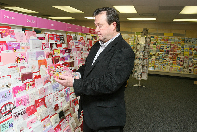 Trent Keller is shopping for Valentine's cards at the Hallmark store downtown Wednesday. PHOTO BY MAIKE SABOLICH
