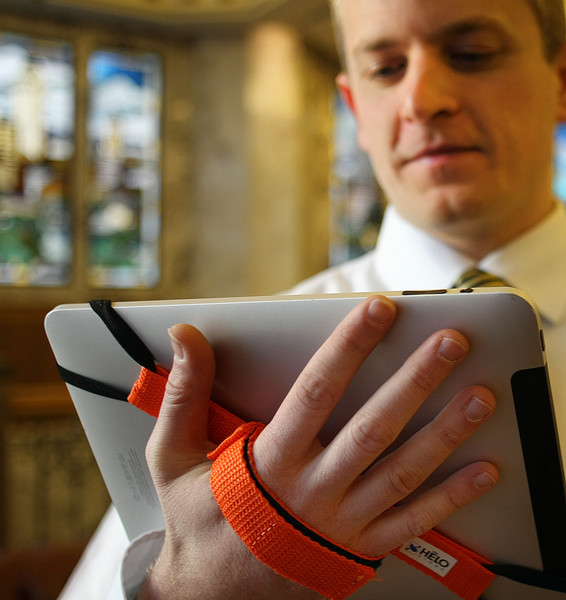 Paul Wizikowski, Inventor of the Tablet Strap 360, demonstrates the product on an IPAD.