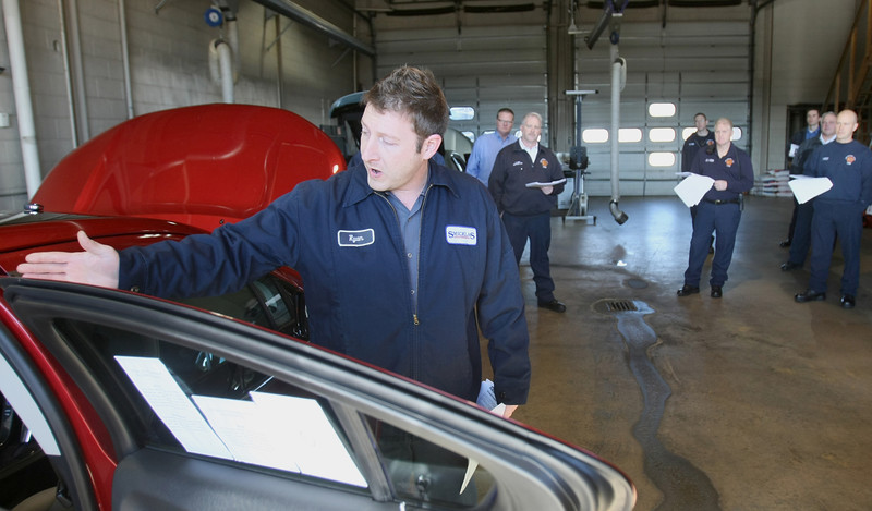 Ryan Fulson with Smicklas explains  to the Oklahoma City Fire Department the proper way to cut into the Chevrolet Volt after an accident.  Smicklas worked with the fire department for a training session Friday at the Lake Hefner fire station. PHOTO BY MAIKE SABOLICH