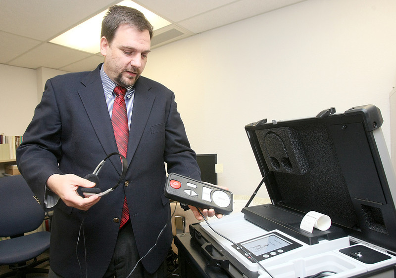 Paul Ziriax, secretary of the state election board, with the audio tactile interface of the eScan A-T voting machine. PHOTO BY MAIKE SABOLICH