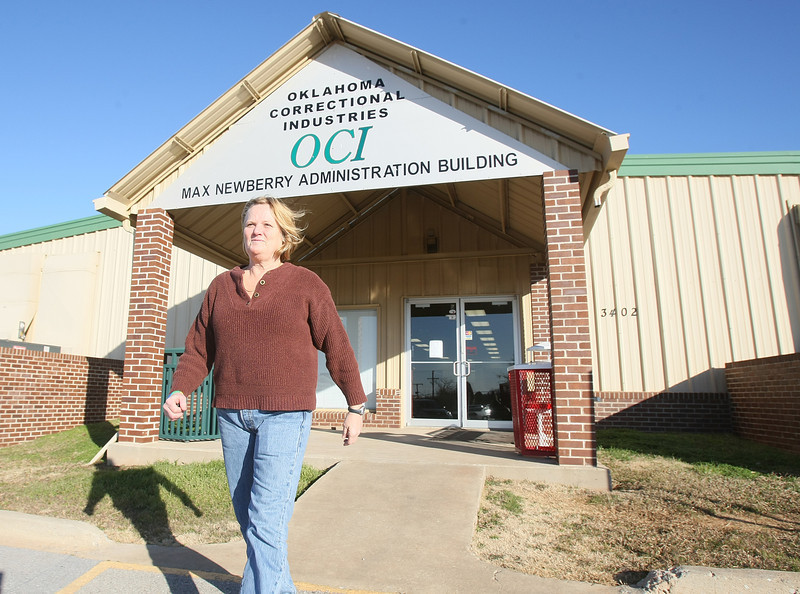 Lanita Hilgenfeld, an employee at Oklahoma Correctional Industries, walks out the door onto the parking lot Tuesday. PHOTO BY MAIKE SABOLICH