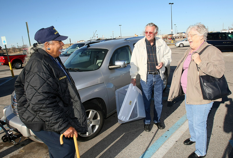 Oneta Jackson, handicap parking investigator for the Oklahoma City Police Department, enjoys a laugh with Jack and Dorothy Elliott while patrolling the Wal Mart parking lot on Memorial Wednesday.  PHOTO BY MAIKE SABOLICH