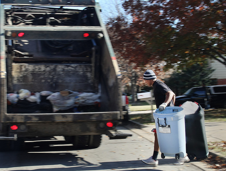 Emmanuel Tino picks up household trash on their route in South Tulsa. Tulsa's trash board has a busy week beginning Monday, facing a lawsuit in Tulsa District Court on Monday and a possible vote on Tuesday by the Tulsa City Council to get the OK to borrow $17 million for trash carts.