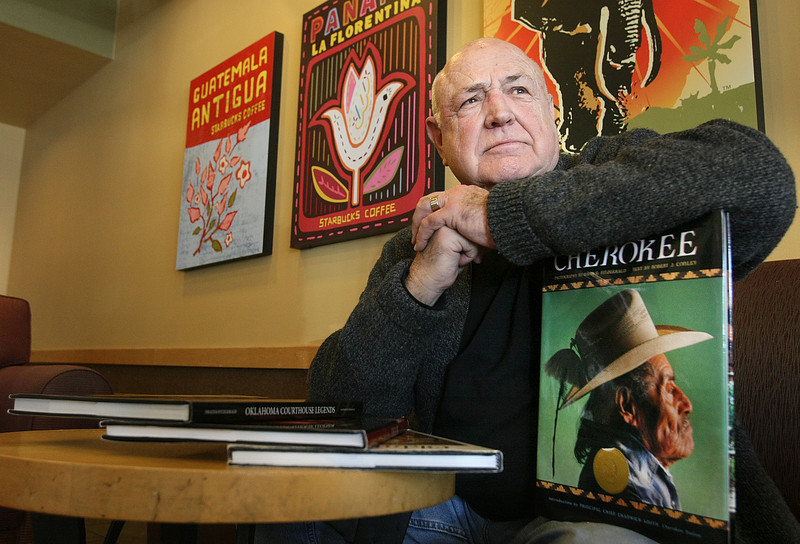 Photographer David Fitzgerald with some of his coffee table book at a Nichols Hills coffee shop. PHOTO BY MAIKE SABOLICH