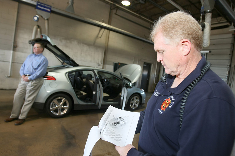 Walter Hawkins with the Oklahoma City Fire Departments reads through the educational material on the Chevrolet Volt during a training session at the Lake Hefner fire station Fiday.  PHOTO BY MAIKE SABOLICH