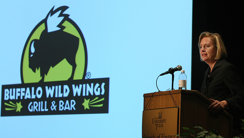 Sally Smith, President and CEO of Buffalo Wild Wings, gives her presentation at the Friends of Finance Luncheon in Tulsa.