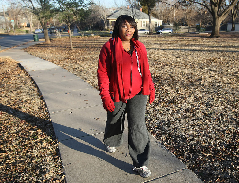 Brandi Matthews-Clark walsk for exercise in her Mesta Park neighborhood Monday. PHOTO BY MAIKE SABOLICH