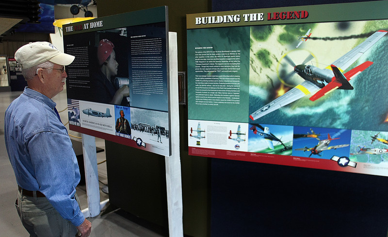 "Jerry Wilson of Owasso studies ""The Test"" display at the Tulsa Air and Space Museum in Tulsa.  The display is the story of the Tuskegee Airmen in WW2."