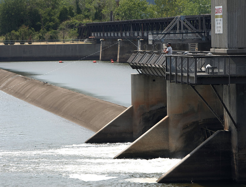 Officials with the Tulsa River Parks Authority are concerned that a lawsuit sparked by state Senator Patrick Anderson will sink planned improvements for the Zink dam.