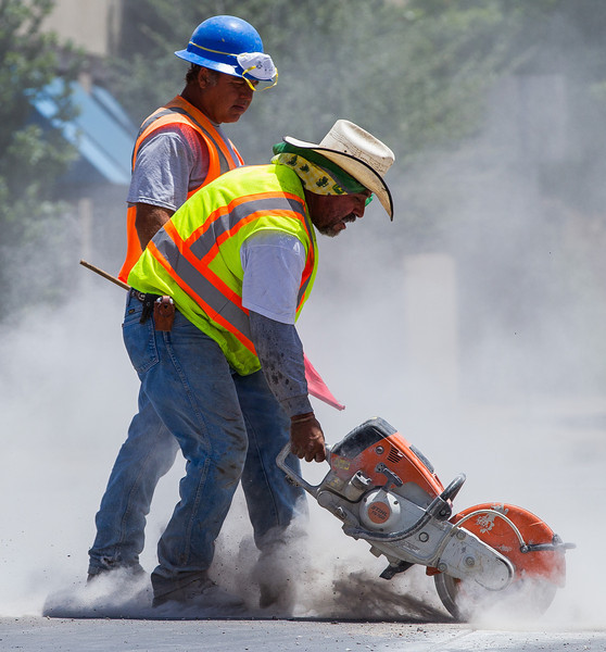 As part of the ongoing construction in downtown Oklahoma City workers cut through concrete that will soon be replaced.
