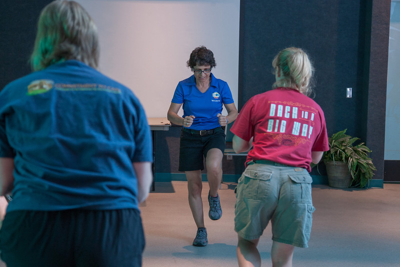 As part of OKC Zoo's F.I.T. program, Sophia Palin leads an exersise class for employees during their lunch break.