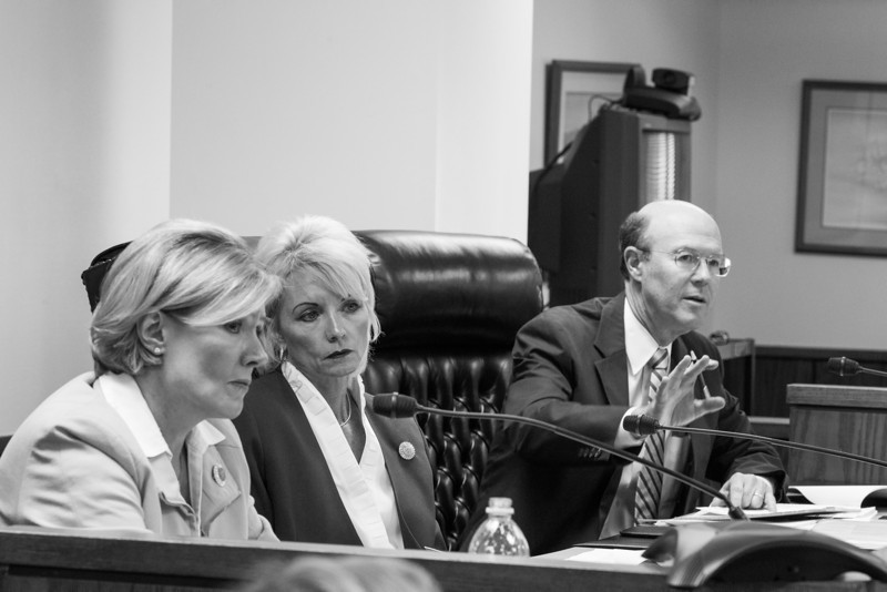 Commisioners Patrice Douglas and Dana Murphy listen while commisioner Bob Anthony ask questions during a Corperation Commision hearing over rate changes pruposed by OG&E.